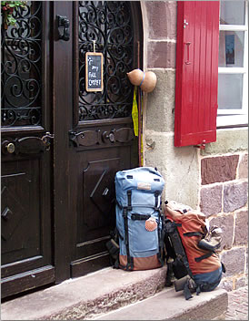 Two backpacks on hostel doorstep, Camino de Santiago.