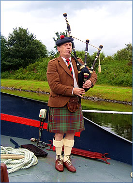 Scottish bagpiper visits European Waterways Scottish Highlander luxury barge.