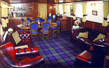 Scottish Highlander barge saloon and dining room, Scottish Highlands nature holidays.