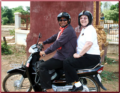 Mom rides a motorbike in Cambodia, planning tips for family travel.