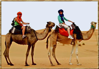 Riding camels in Morocco: budget travel for seniors.