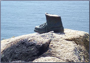 Pilgrim boot at Cap Finisterre marks the end of the Camino de Santiago in Galicia, Spain.