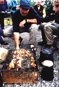 Campfire cooking on a river rafting vacation in Canada's Yukon territory.