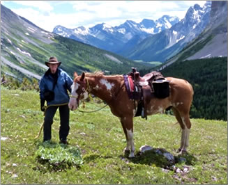 Man and horse in the Canadian Rocky Mountains.