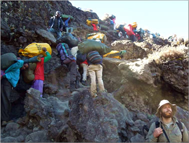Mt Kilimanjaro trekking tours Tanzania include steep climbs up canyon walls on some days.