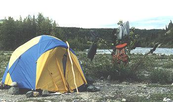 Tenting along the river bank during Tatshenshini river rafting vacation.