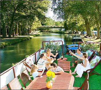 European Waterways barging vacations for families on French canals: family travel cruise holidays.
