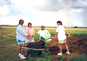 Digging dirt can be part of a volunteer vacation.
