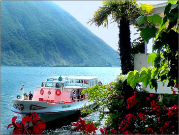 Ferry boat takes visitors to village of Gandria, Ticino, Switzerland.