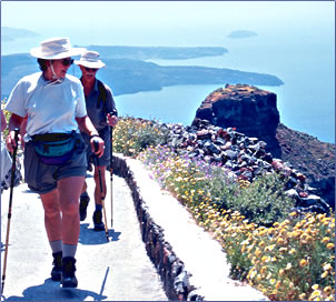 Trekking poles help seniors on walking and hiking vacations in Greece.