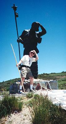 Pilgrim Henry Maloney poses with the Camino de Santiago statue
