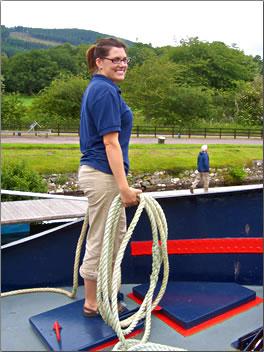 Scottish Highlander barge vacation hostess on deck.