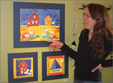 Artist Francine Bourque paints colorful houses on Les Iles de la Madeleine, Quebec Magdalen Islands travel.