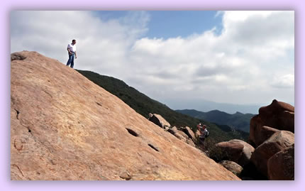 Rock climbing in mountain scenery, Living your destiny through travel.