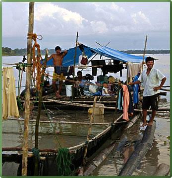 Peru Amazon river, local villagers, small ship cruise visit.