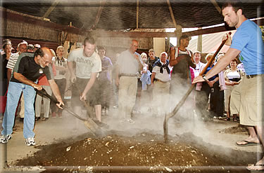 Hangi meal preparation: Rotorua Maori cultural travel.