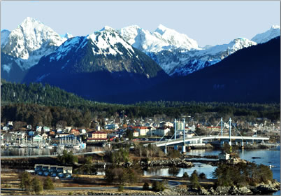 Travel to Sitka Alaska, photo of townsite and mountains.