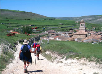 Trekking poles help seniors on walking vacations like Spain's Camino de Santiago.