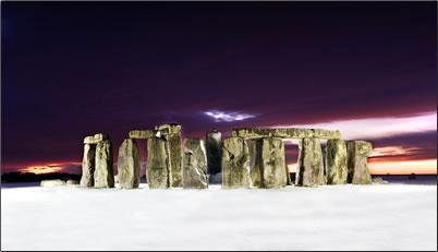 Stonehenge in winter's snow.