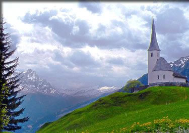 Church outside Tenna village in the mountains of Switzerland.