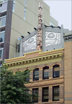 First native-owned hotel in downtown Vancouver, B.C., Skwachays Lodge totem pole exterior.