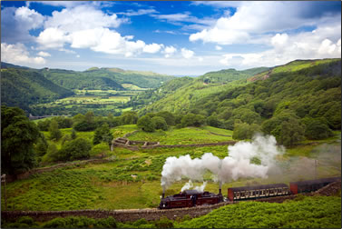 Heritage steam train rides for visitors in Wales.