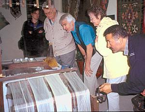 Making silk threads for Turkish carpet weaving.