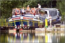 European Waterways barge in lock during canal cruise.