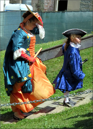 Mother and son dress in historic costumes at Quebec City's New France Festival.