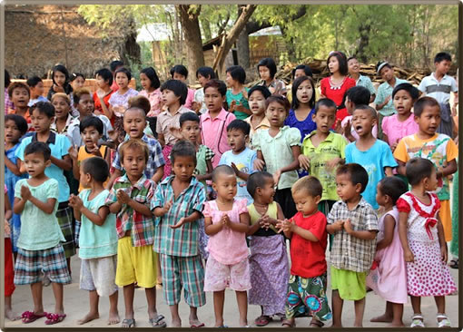 Myanmar school children sing for Irrawaddy River cruise guests.