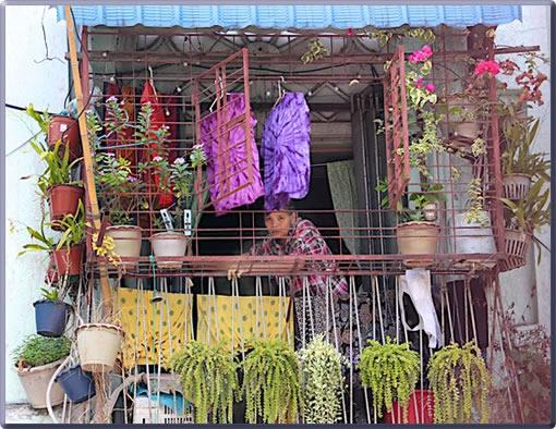 Myanmar urban life, colorful balcony.