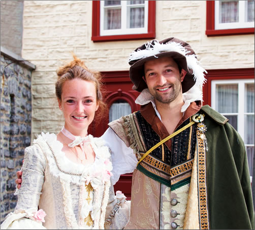 A young couple in 17th century costume at Quebec City's New France Festival.
