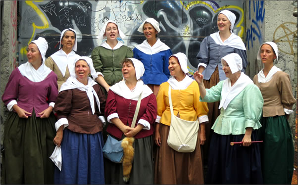 A choir of women in period costume perform traditional melodies at Quebec City's New France Festival.