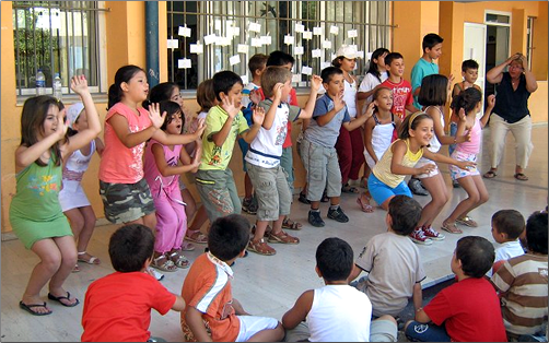 Children learn English by group singing.