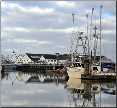 Fishing boat with Gulf of George Cannery National Historic Site in background at Steveston, B.C.