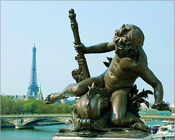 A bronze cherub points the way to Paris's Eiffel Tower.