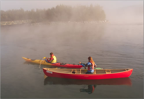 Early morning canoeing and kayaking on Yukon River near Whitehorse.
