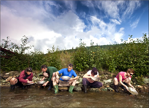 Gold Panning is contagious at Gold Bottom Creek near Dawson City.