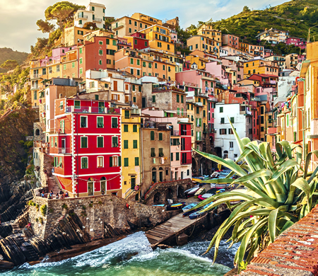 Cinque Terre is a string of centuries-old seaside villages clinging to a rugged Italian Riviera coastline.