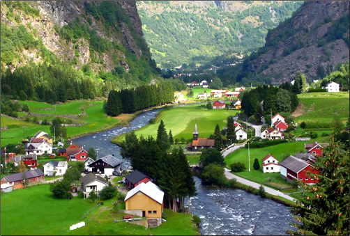 Visit the village of Flåm in southwestern Norway, in an area known for its dramatic fjords.