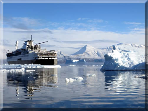 The Ocean Endeavour navigates past mountains and icebergs.