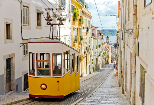 With each itinerary allowing time for independent exploration, hop on a Lisbon tram during your Portugal tour.