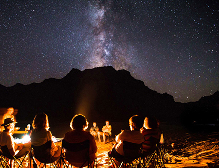 Enjoy evenings around a camp fire in Colorado's Yampa Canyon.